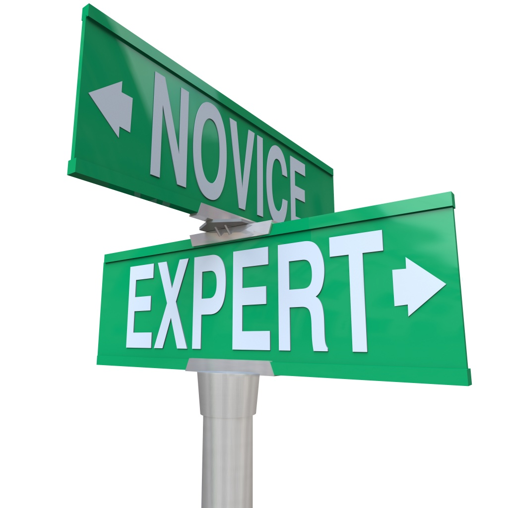 Expert Vs Novice words on green two way road signs to illustrate the power of skills, expertise and experience to get a job done or task completed